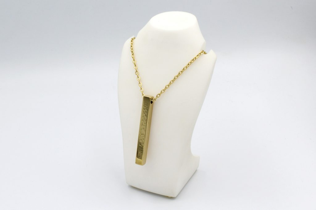 gold style bar necklace on a bust