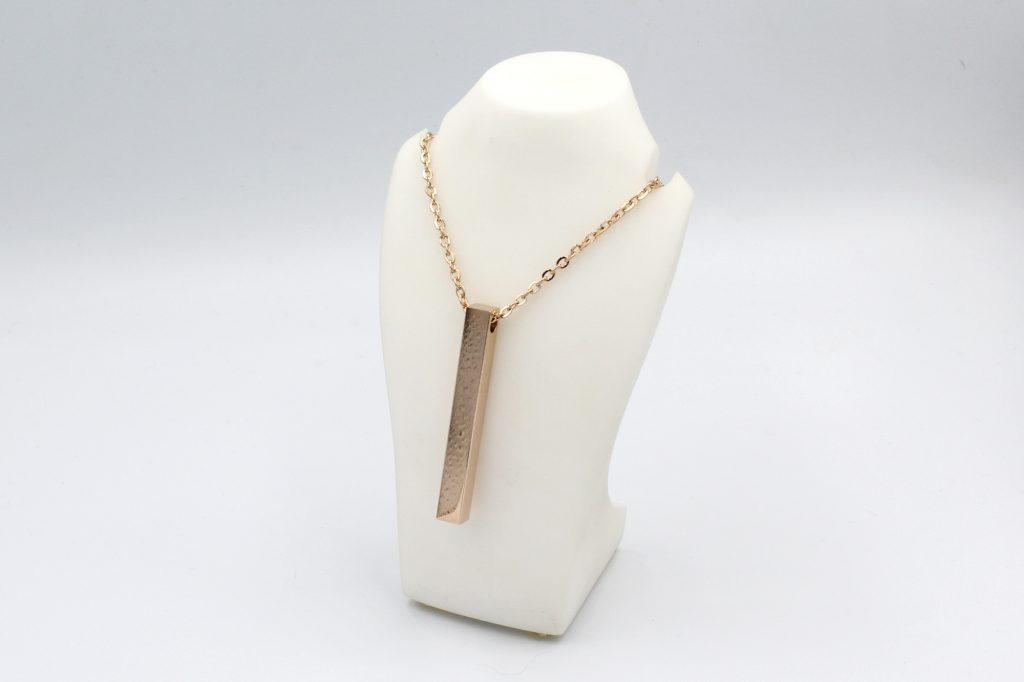 rose gold style bar necklace on a bust