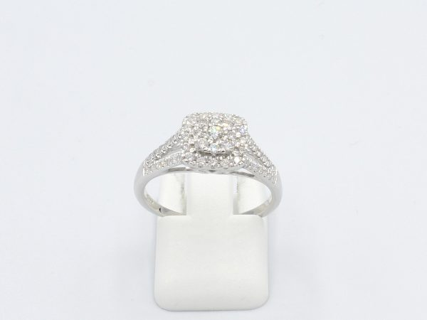 front view of multi-diamond halo engagement ring on white background