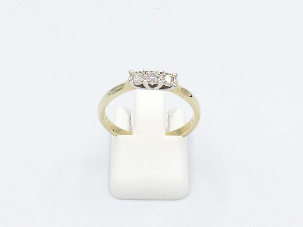 front view three diamond engagement ring on white background