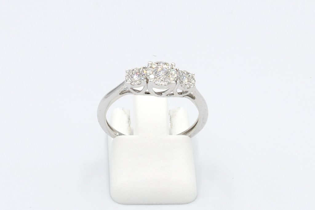 front view of white gold multi-diamond engagement ring on white background