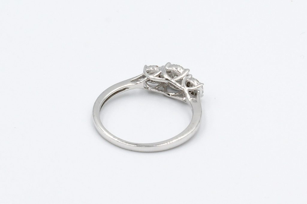 rear view of white gold multi-diamond engagement ring on white background