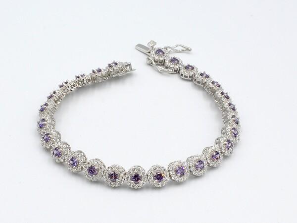 a bracelet set with multiple amethyst style cubic zirconia gemstones