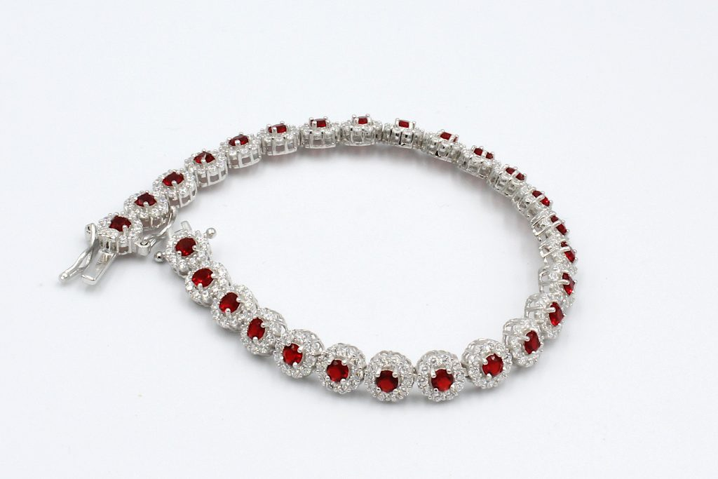 a bracelet set with multiple ruby style cubic zirconia gemstones