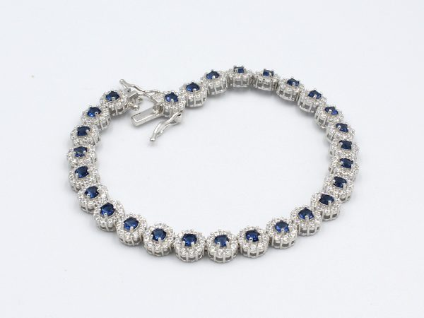 a bracelet set with multiple sapphire style cubic zirconia gemstones