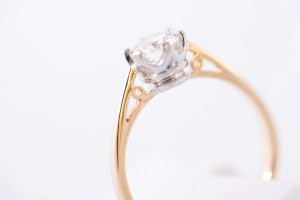 close up of a gold diamond engagement ring