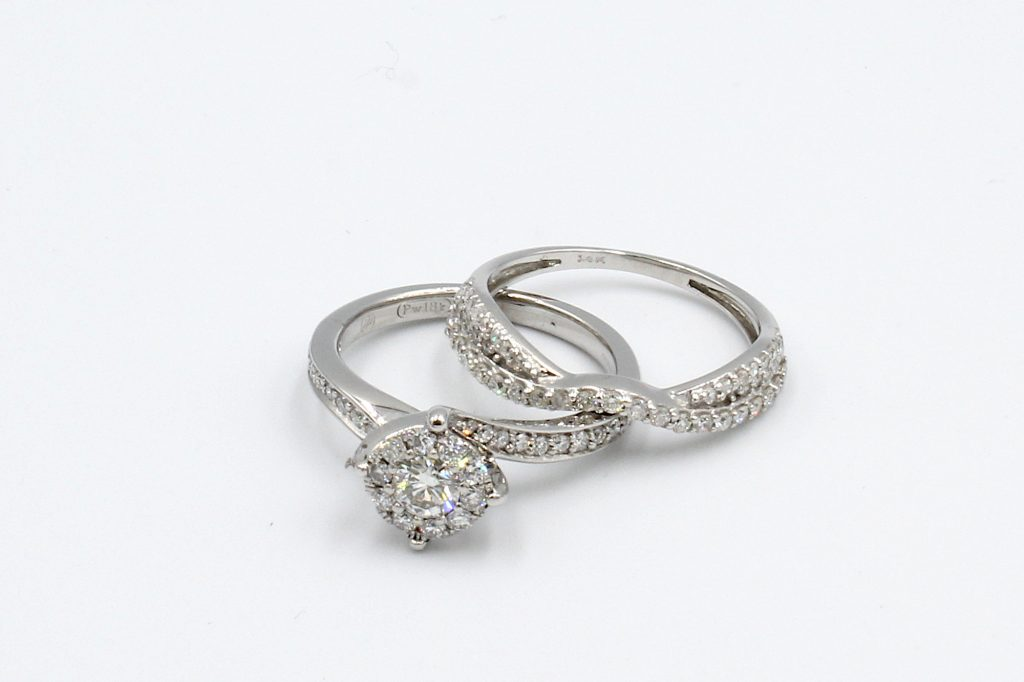 top view of two shaped diamond rings that fit perfectly together