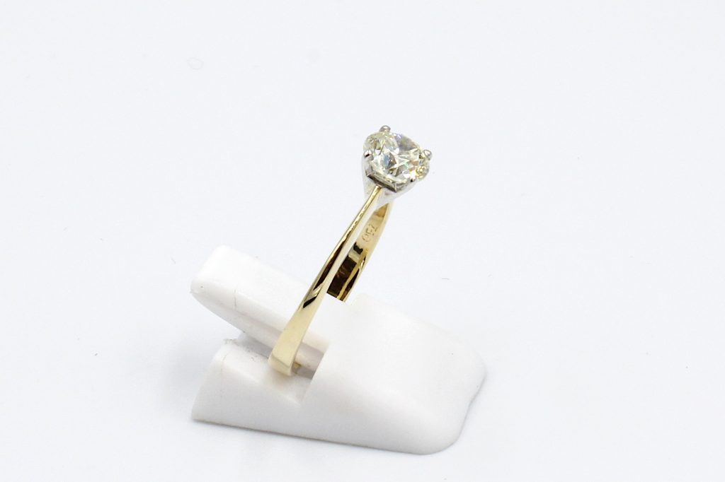side view of a gold solitaire diamond ring