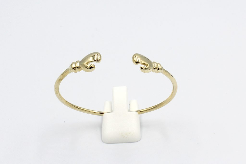 front view f a solid gold torq baby bangle