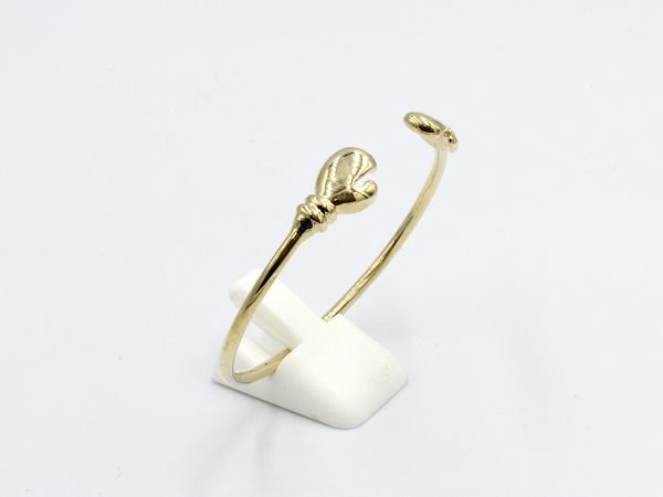 side view f a solid gold torq baby bangle