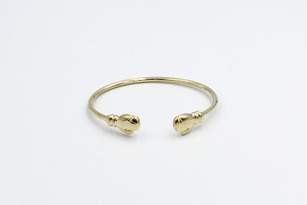 top view f a solid gold torq baby bangle