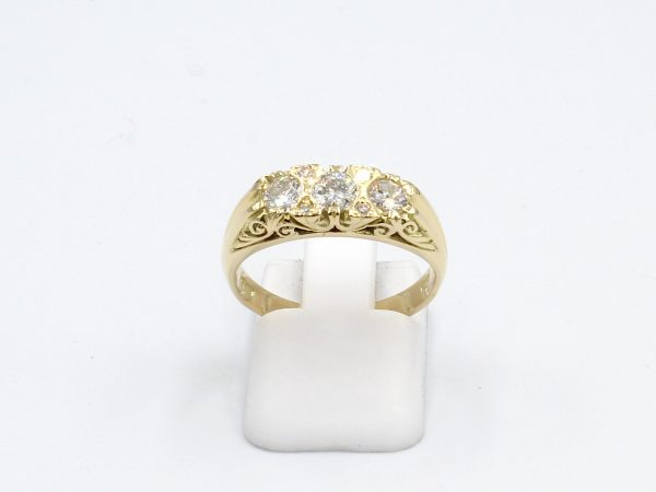 front view of a gold vintage style diamond ring