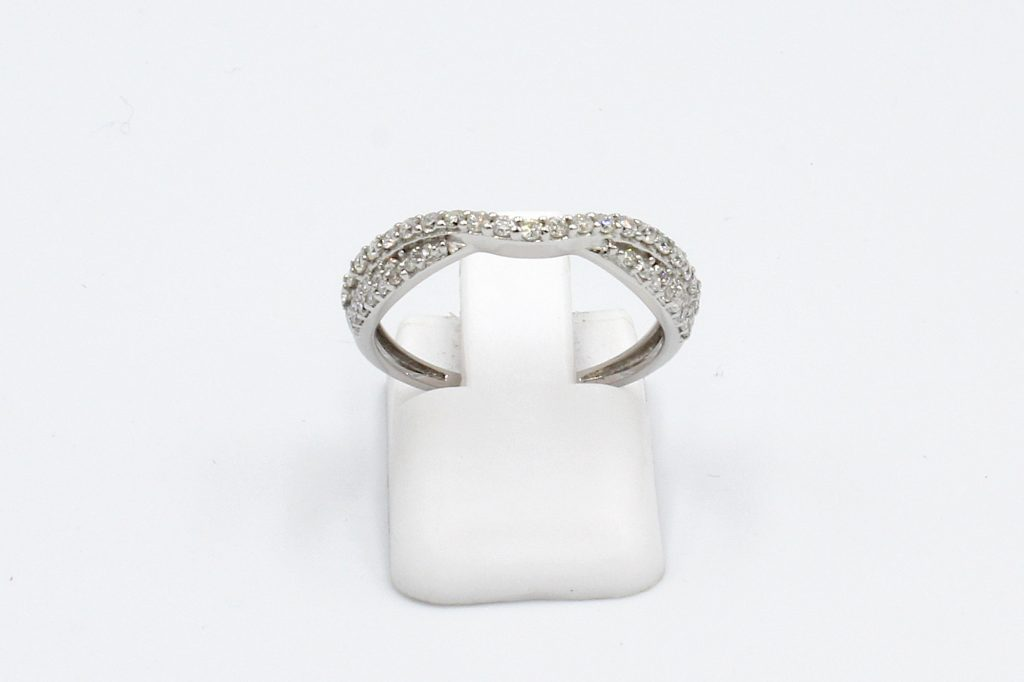 front view of a shaped and twisted wedding ring encrusted with diamonds