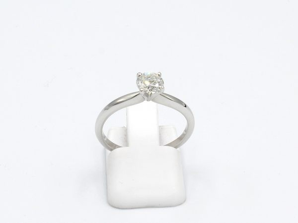 front view of a solitaire diamond ring made from platinum