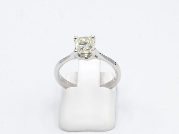 front view of a platinum ring with princess cut solitaire diamond