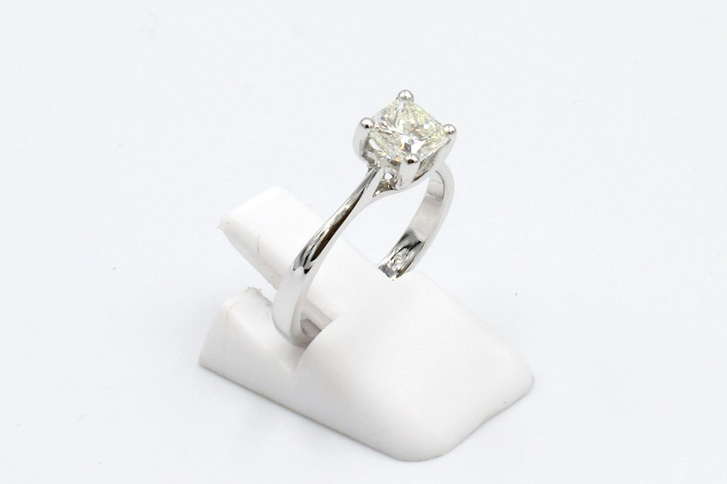 side view of a platinum ring with princess cut solitaire diamond