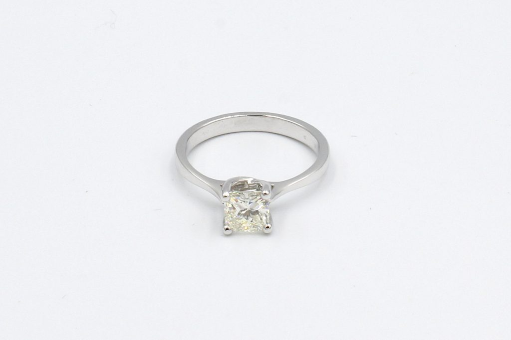top view of a platinum ring with princess cut solitaire diamond