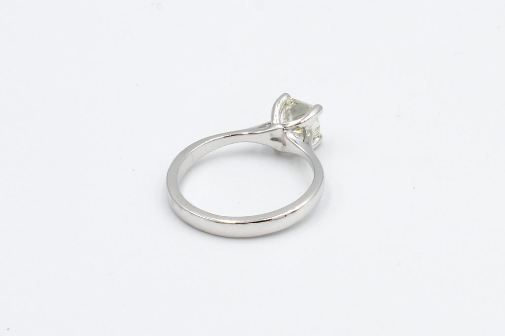 rear view of a platinum ring with princess cut solitaire diamond