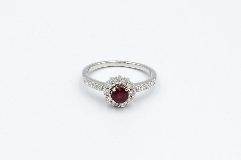 top view of a white gold ruby and diamond engagement ring