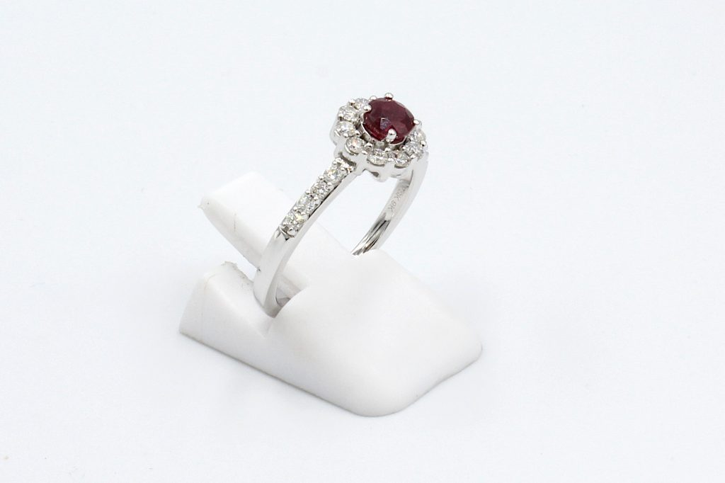 side view of a white gold ruby and diamond engagement ring