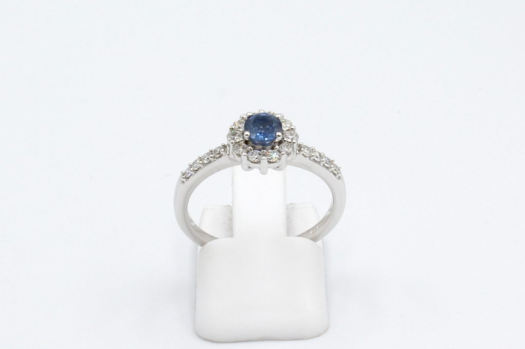 front view of a white gold sapphire and diamond engagement ring