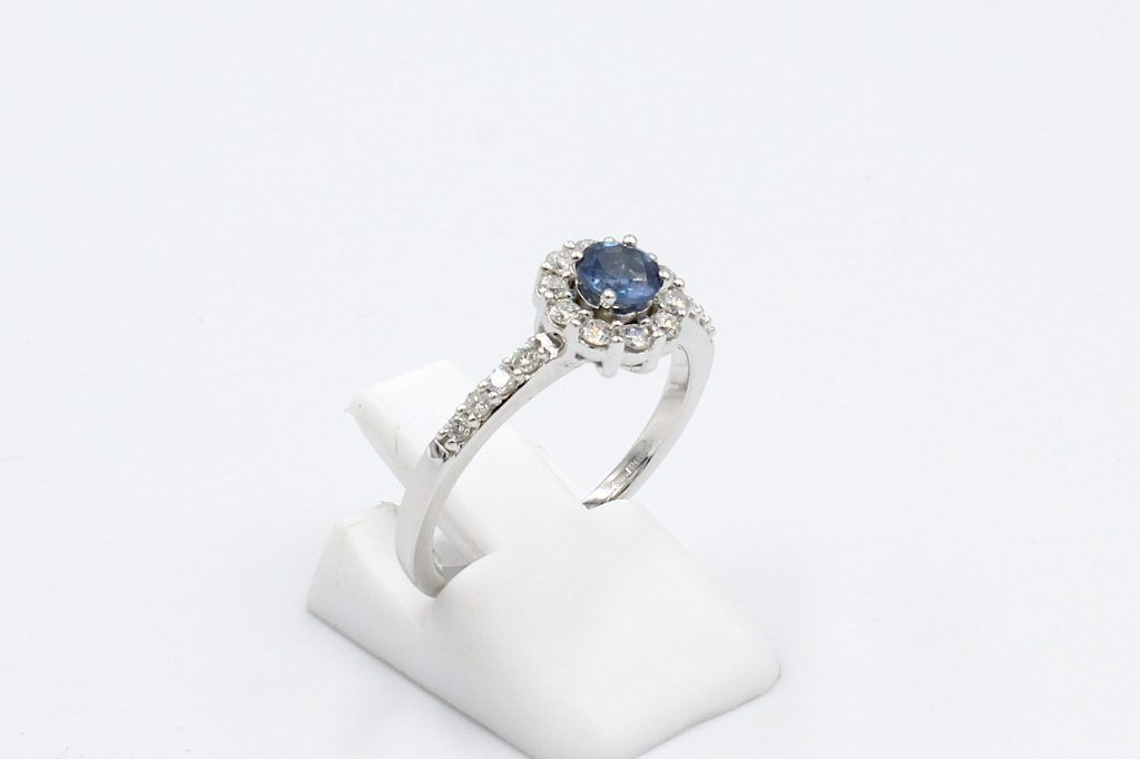side view of a white gold sapphire and diamond engagement ring