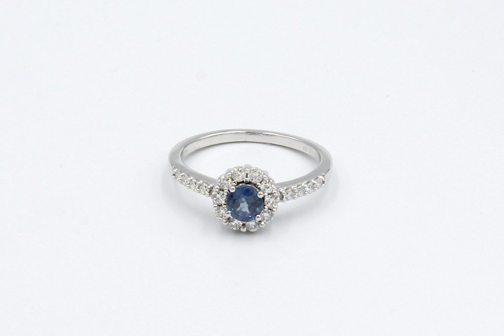 top view of a white gold sapphire and diamond engagement ring