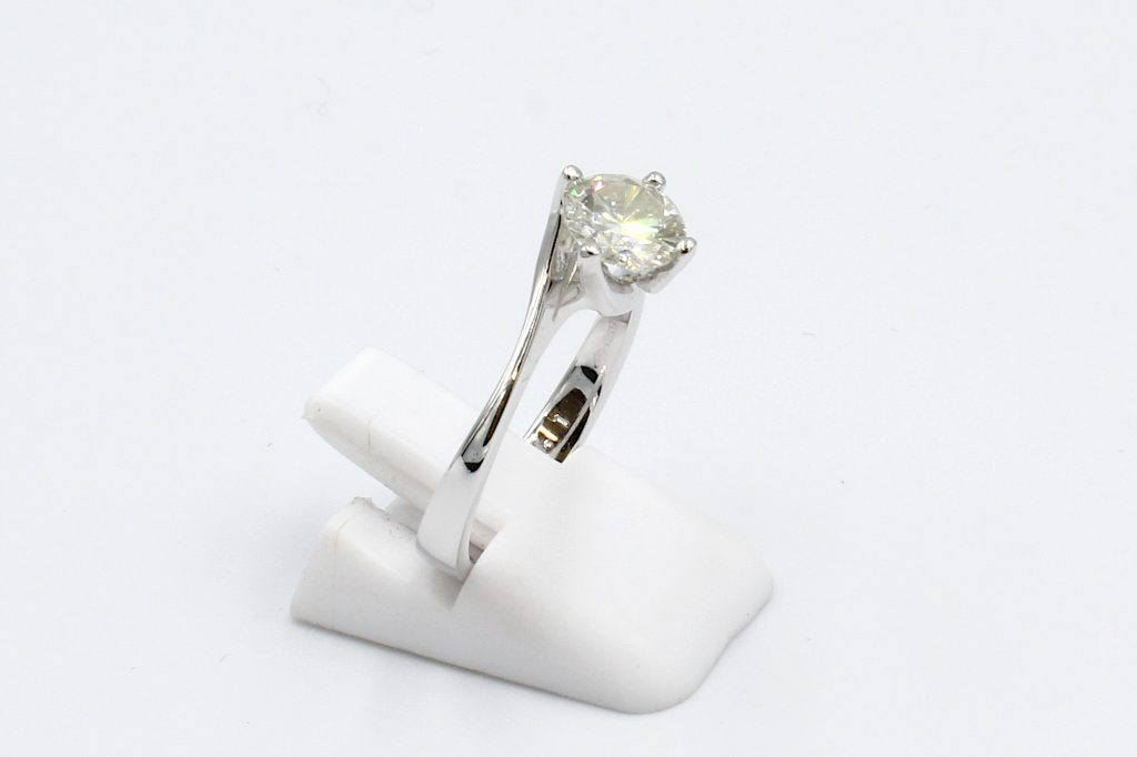 side view of a platinum solitaire diamond engagement ring -