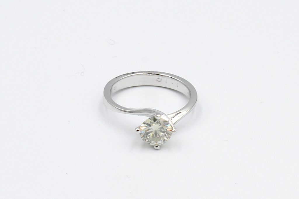 top view of a platinum solitaire diamond engagement ring -