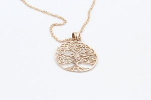 a tree of life pendant made from rose gold