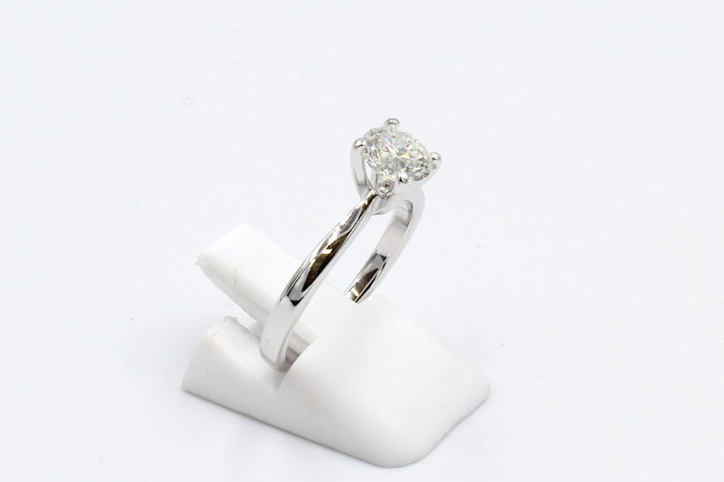 side view of a white gold diamond solitaire ring