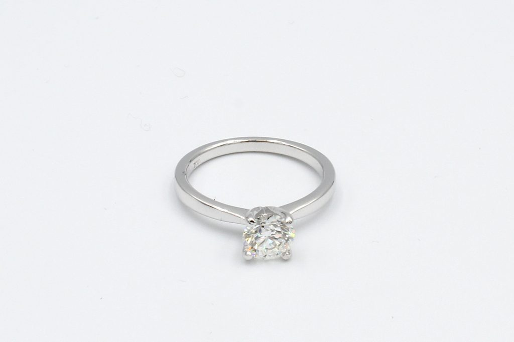 top view of a white gold diamond solitaire ring
