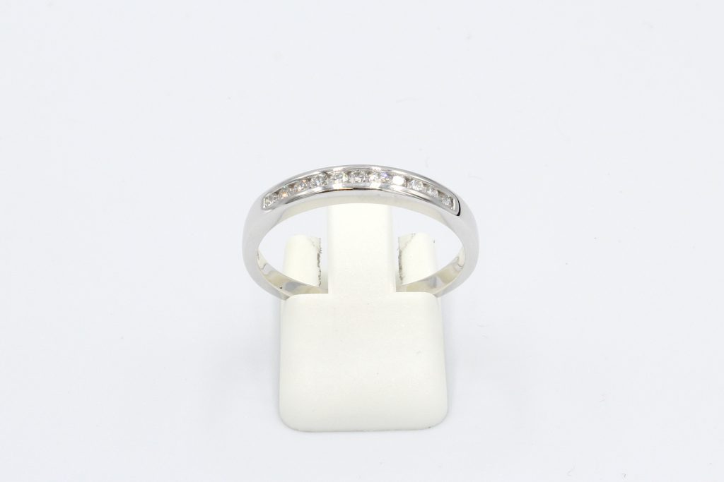 front view or a diamond channel set wedding ring