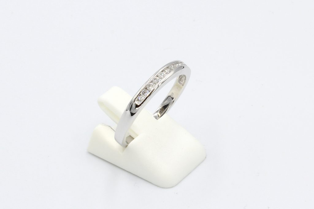 side view or a diamond channel set wedding ring