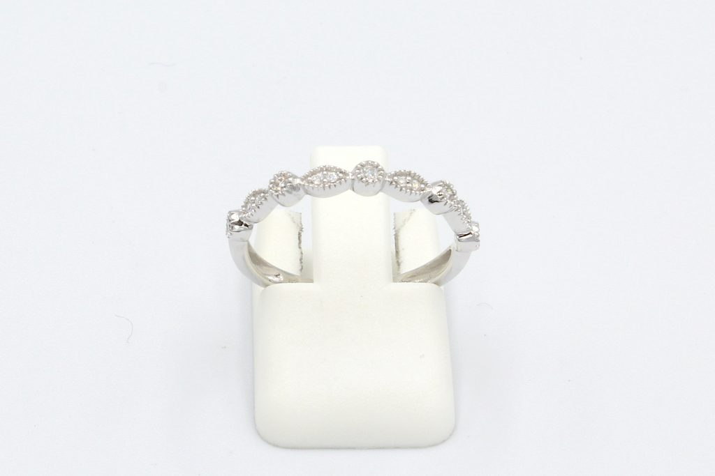front view of a diamond vintage round and marquee style wedding ring