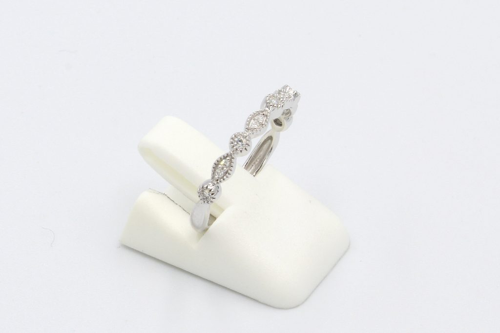 side view of a diamond vintage round and marquee style wedding ring