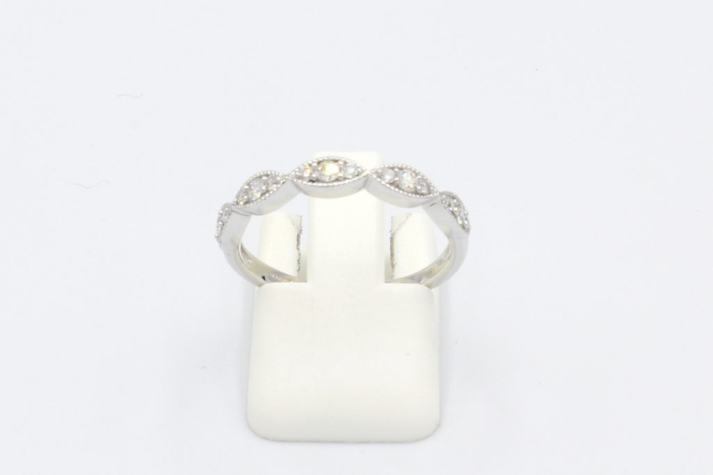 front view of a diamond set vintage style marquee ring
