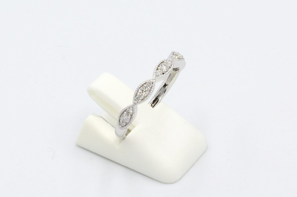 side view of a diamond set vintage style marquee ring