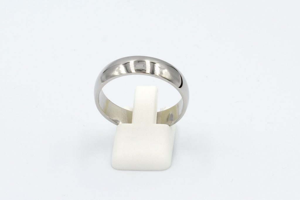 front view of a platinum wedding ring on a white background