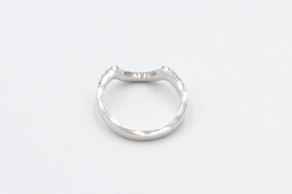 rear view of a shaped diamond wedding ring
