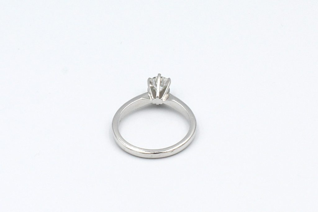 back view of a white gold solitaire diamond ring