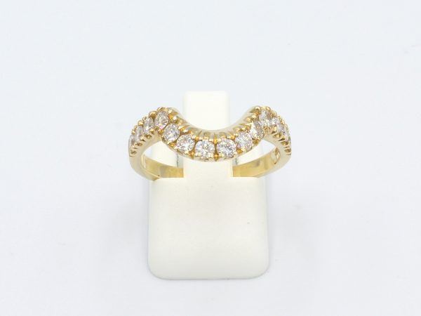 front view of a diamond castille set shaped wedding ring in yellow gold