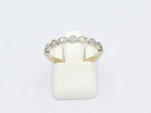 front view of a gold vintage style marquee, milgrain ring set with diamonds