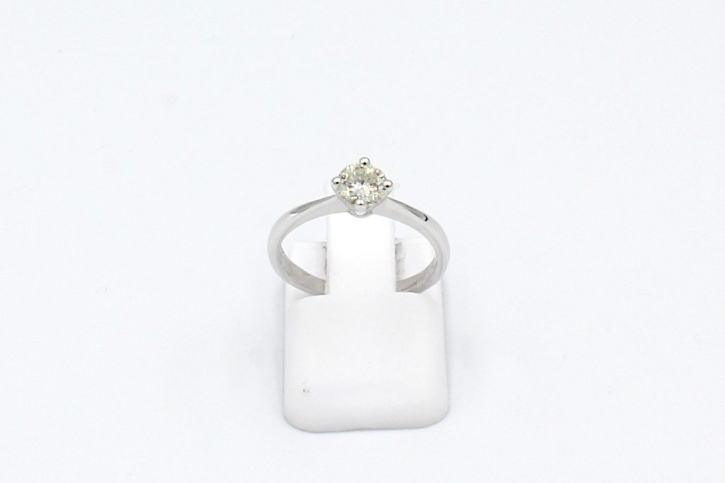 front view of a platinum solitaire diamond ring