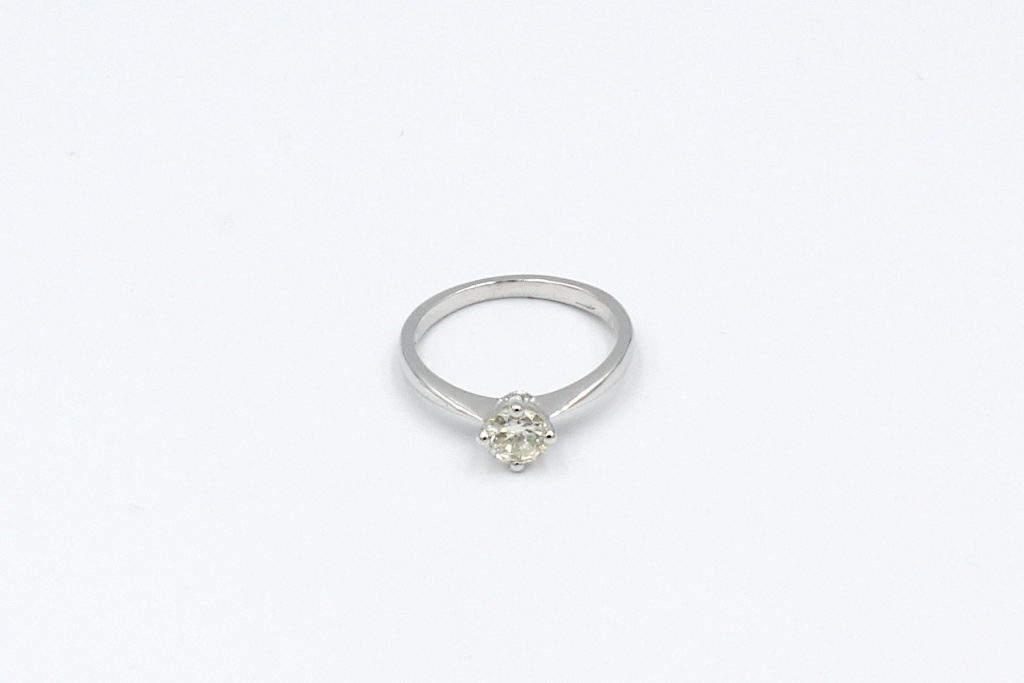 top view of a platinum solitaire diamond ring