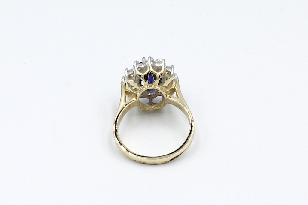 back view of a sapphire and diamond cluster ring made from gold