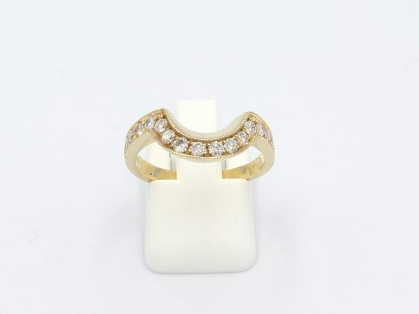 front view of a gold and diamond shaped wedding ring