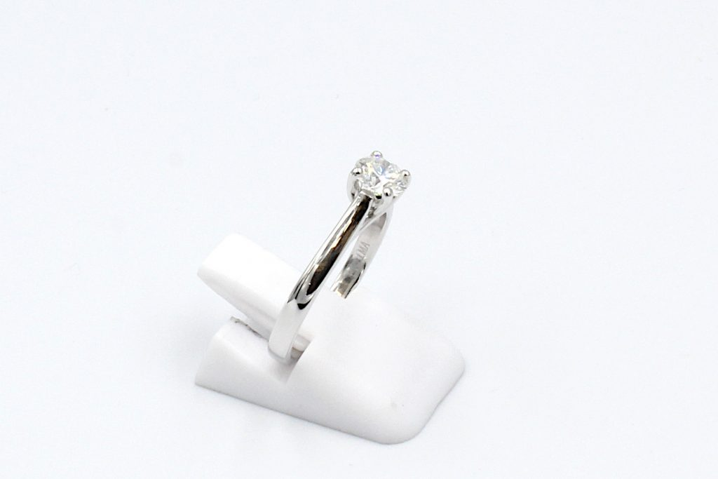 side view of a white gold solitaire diamond ring