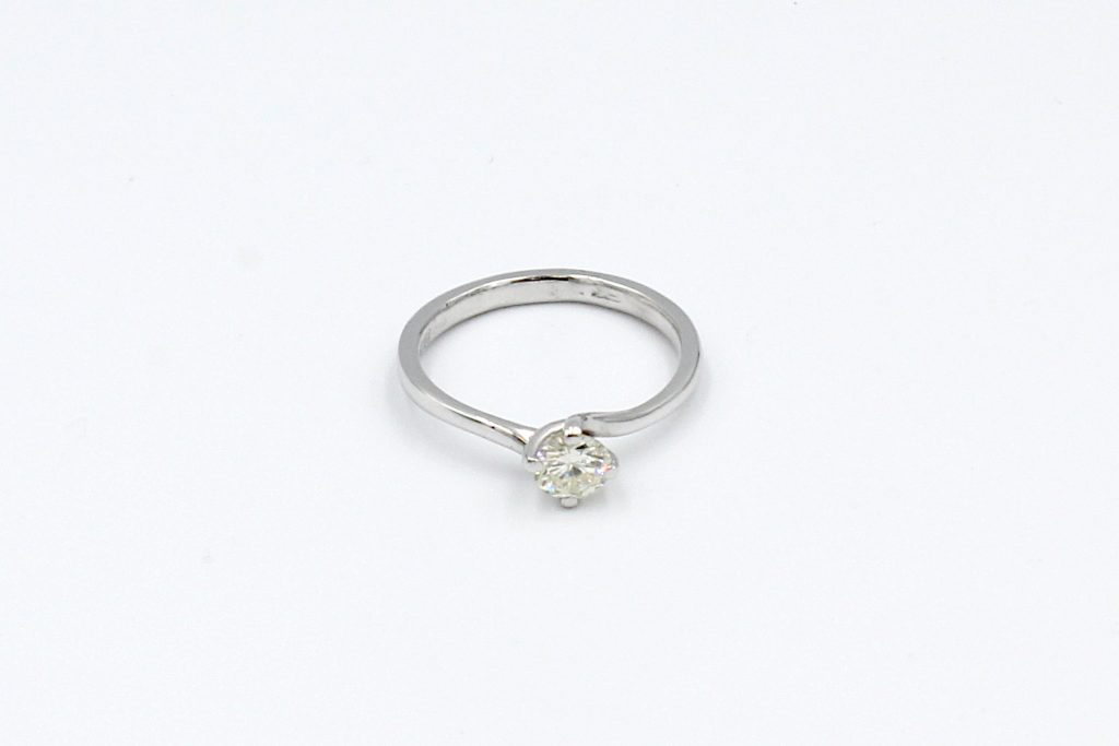 top view of a white gold solitaire diamond ring