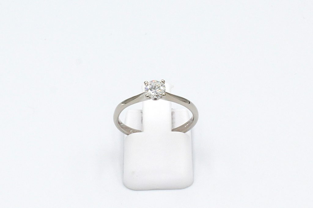 front view of a white gold solitaire diamond ring
